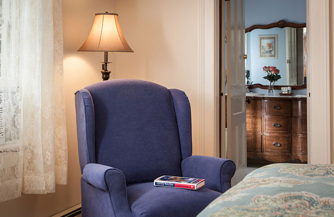 Chair, Book and Lamp in a Cooperstown Bed and Breakfast
