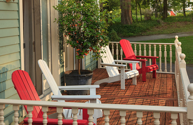 Cooperstown Dreams Park Lodging - Porch and Chairs