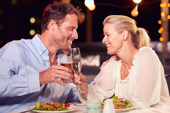 couple out to dinner with beer and champagne