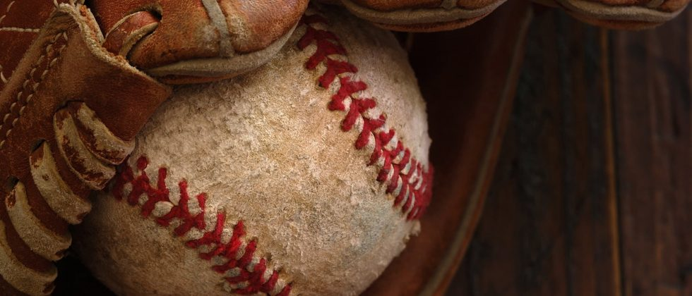 worn baseball in a glove