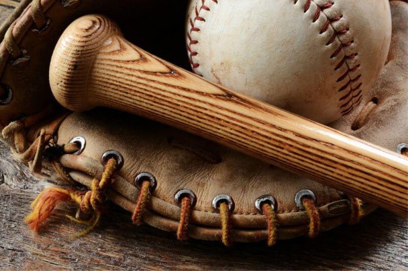 a baseball glove, bat, and ball