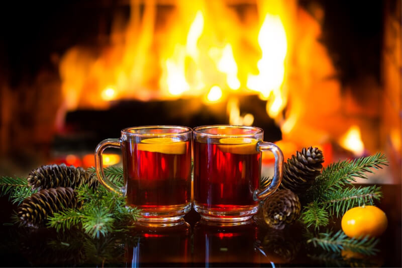 hot drinks in front of a fireplace