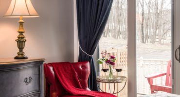 Cozy guest room at Landmark Inn during the winter