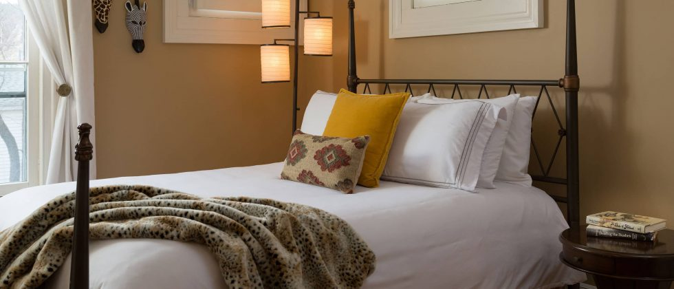 Plush bed with iron-frame headboard