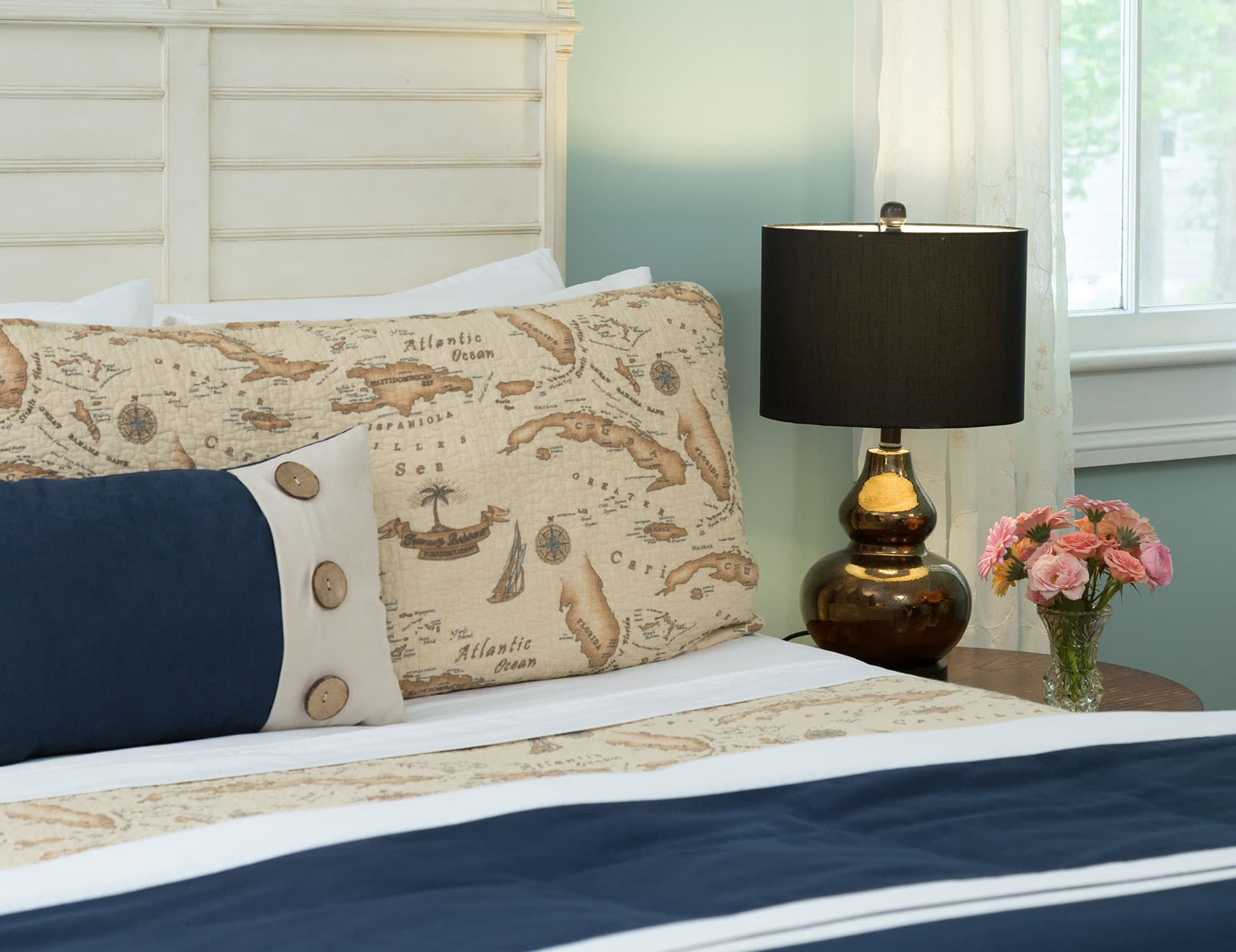 Pillows with antique-style map designs