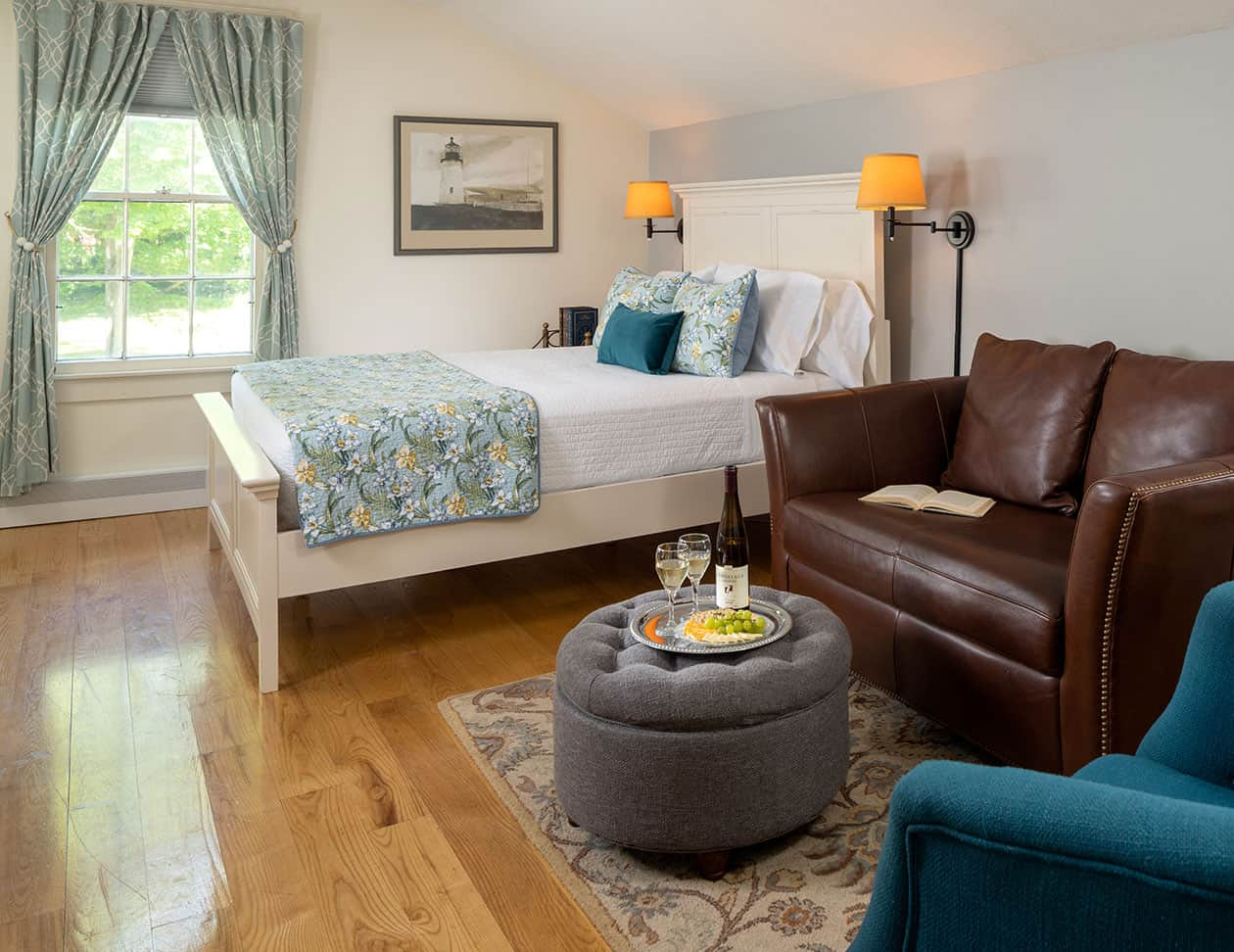 Bed by sitting area in the Wyeth room - Cooperstown, NY Inn