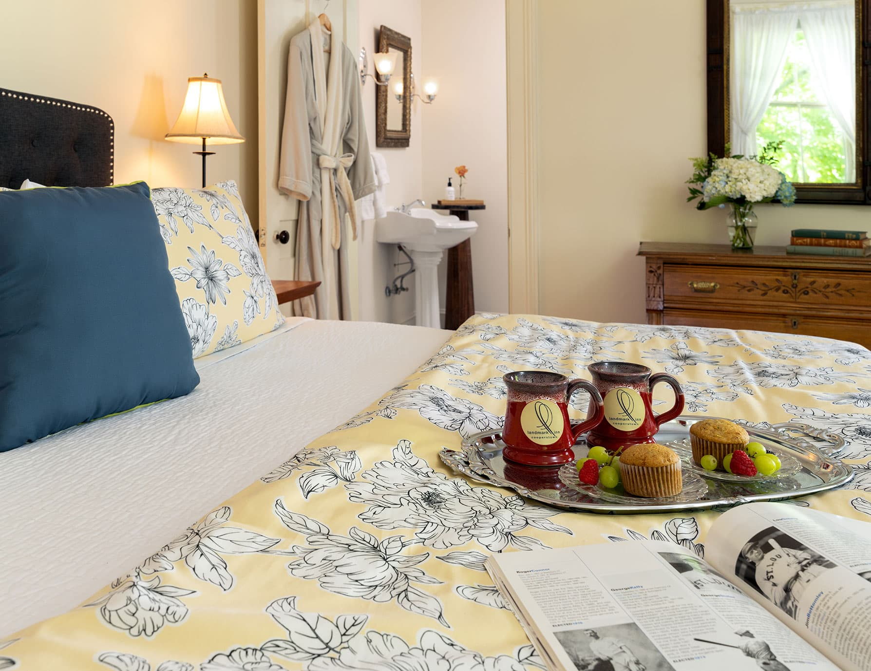 Tray with coffee and snacks for two on bed at a Cooperstown Bed and Breakfast