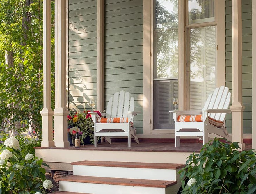 Adirondack chairs outside on the Landmark Inn porch in Cooperstown, NY