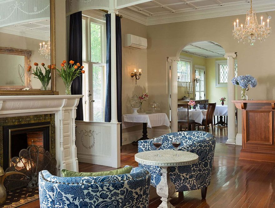 Sitting area with fireplace and chandelier in the Landmark Inn