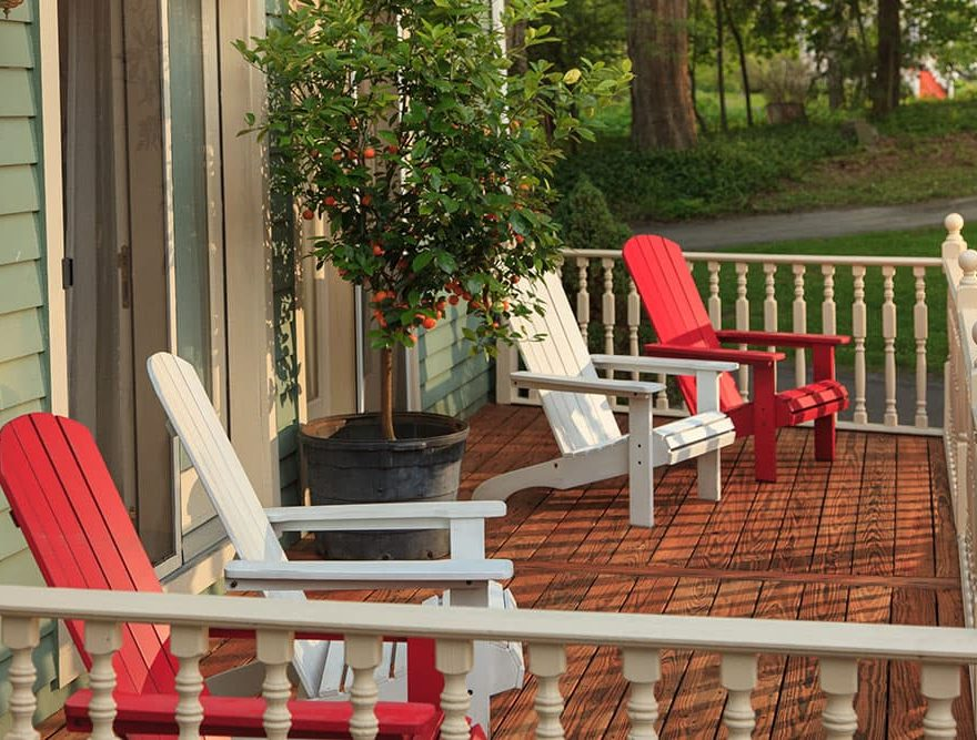 Porch with spaced Adirondack chairs