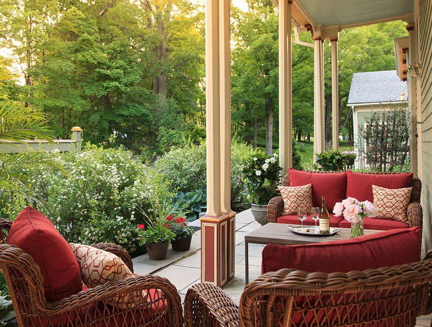 Sitting area outside the Landmark Inn with verdant plants nearby