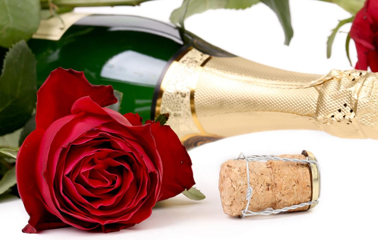 Bottle of Champagne with Red Rose