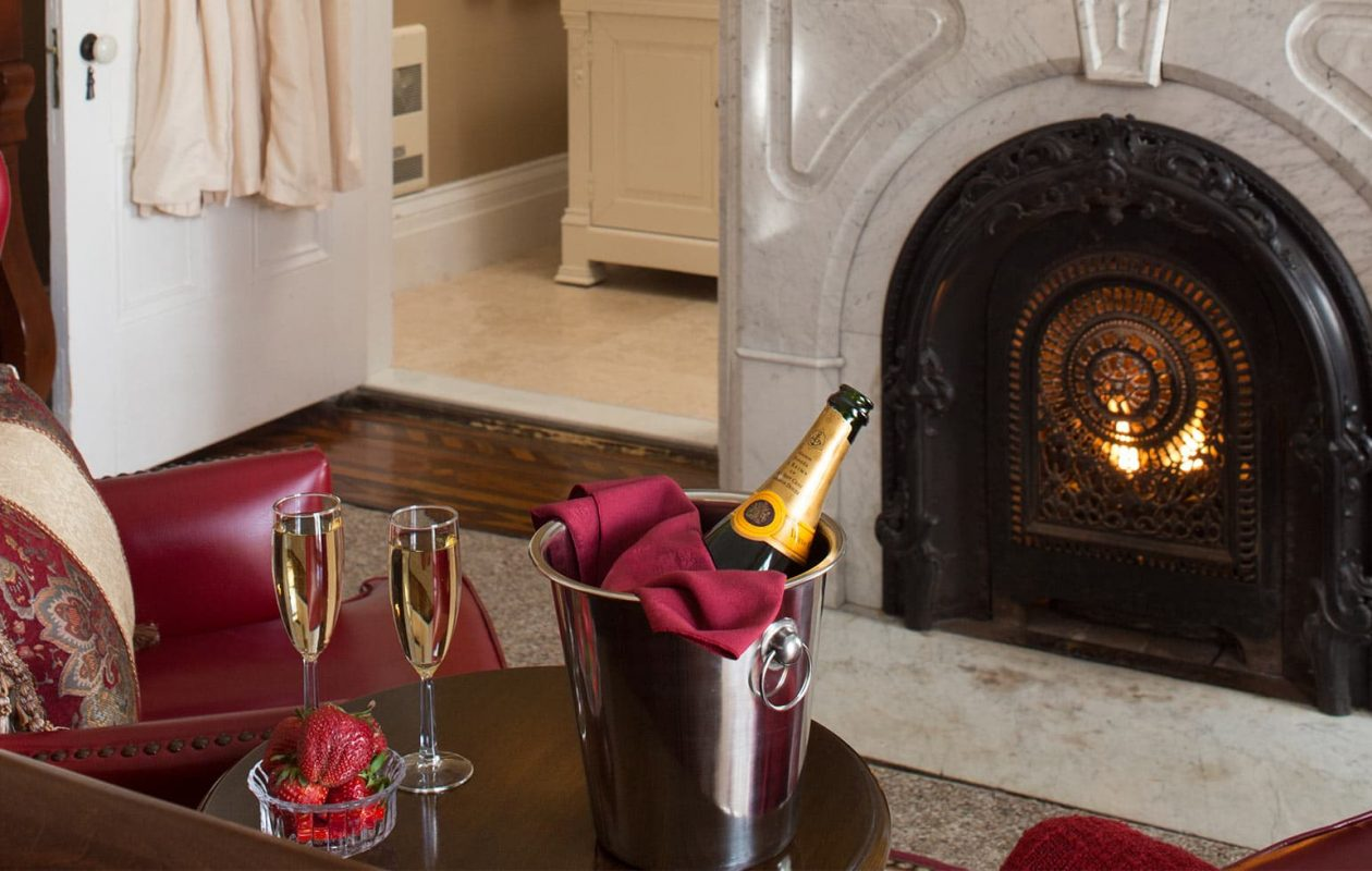 Champagne and Strawberries by a fireplace