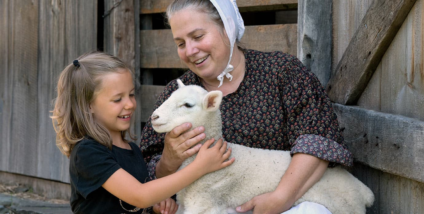 Child seeing animal at Farmers' Museum in Cooperstown