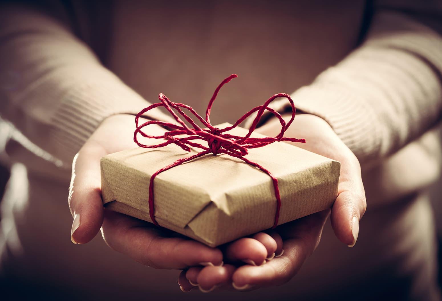 Woman Holding a Landmark Inn Gift Certificate