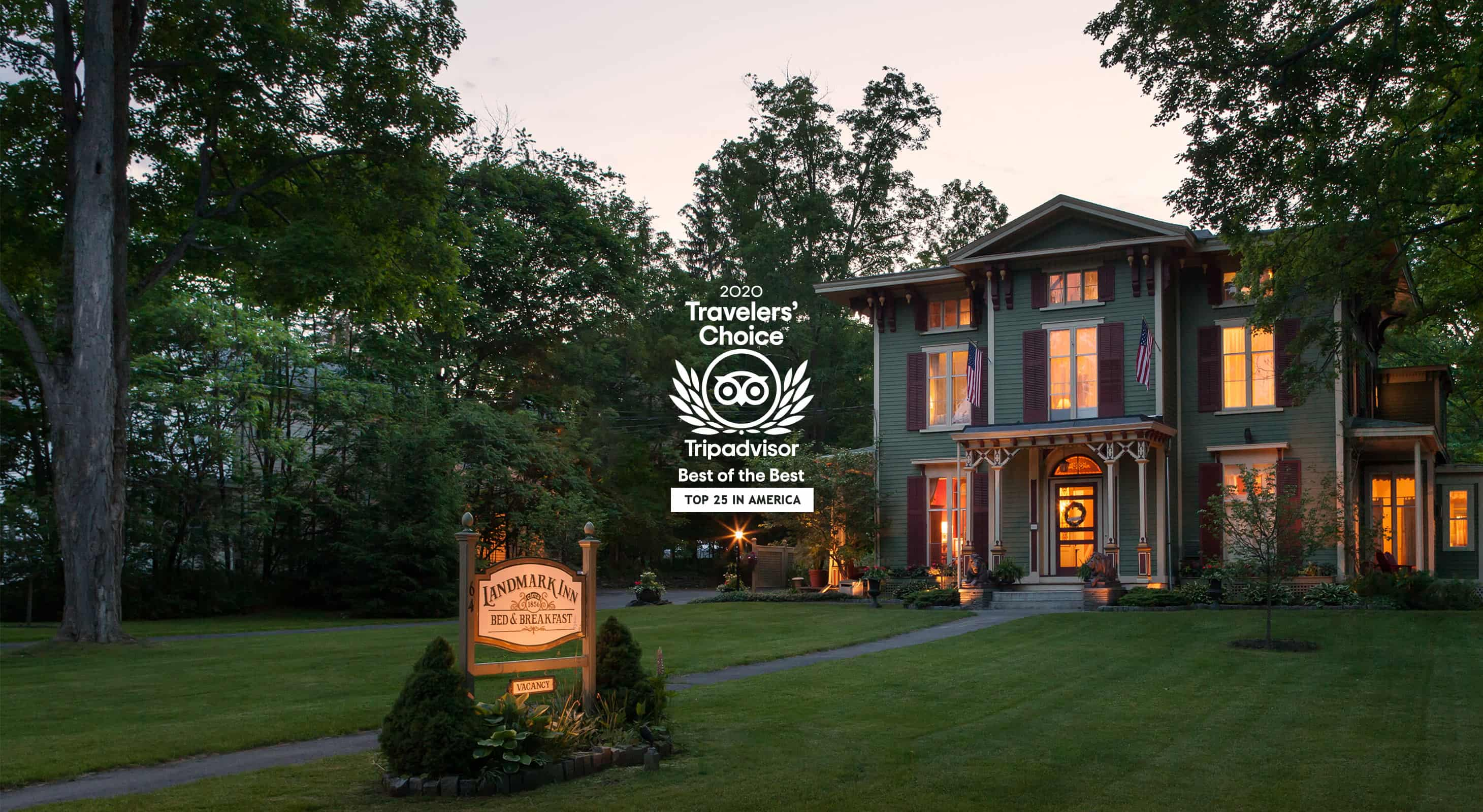 Exterior of inn at dusk with 2020 Travelers Choice logo from TripAdvisor