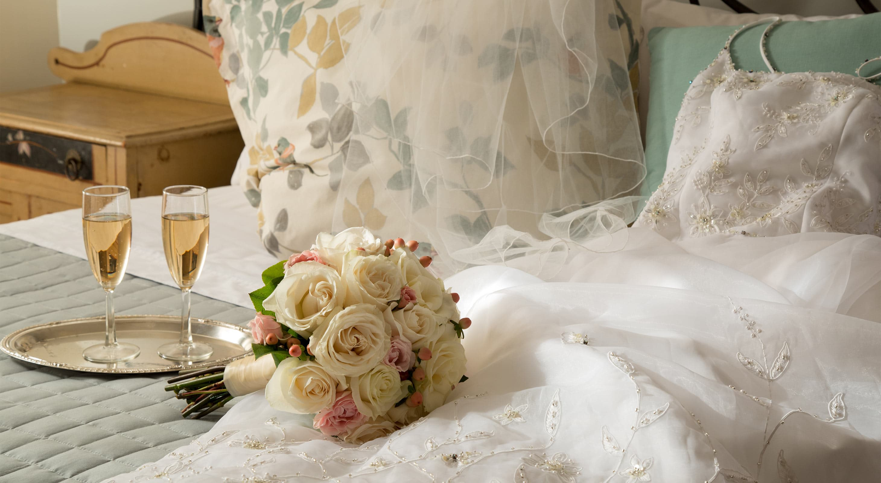 wedding dress and bouquet with Champagne at a Cooperstown NY Inn